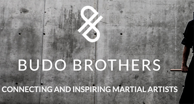 "Two lowercase ""B""s intertwine to make the Budo Brothers logo with text, ""Budo Brothers Connecting and inspiring martial artists."""